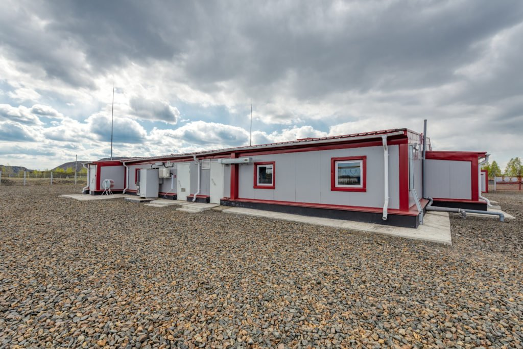gray with red trim shipping container building